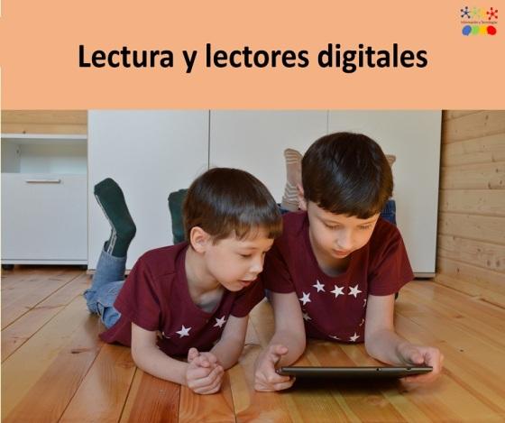 dos niños tirados en el piso leyendo de una tableta